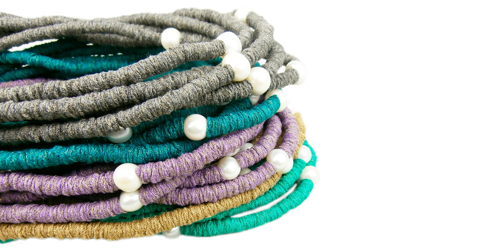 necklaces handcrafted with natural pearls.